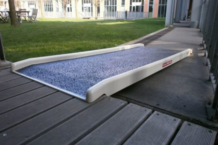Making the entrance to a business accessible for an employee in a wheelchair with anti-slip ramp