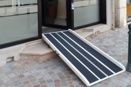 Briefcase ramp for two steps in an insurance office