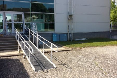making a municipal pool accessible with several fibreglass standard access ramp with double handrail