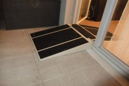 terrace access with a folding threshold ramp