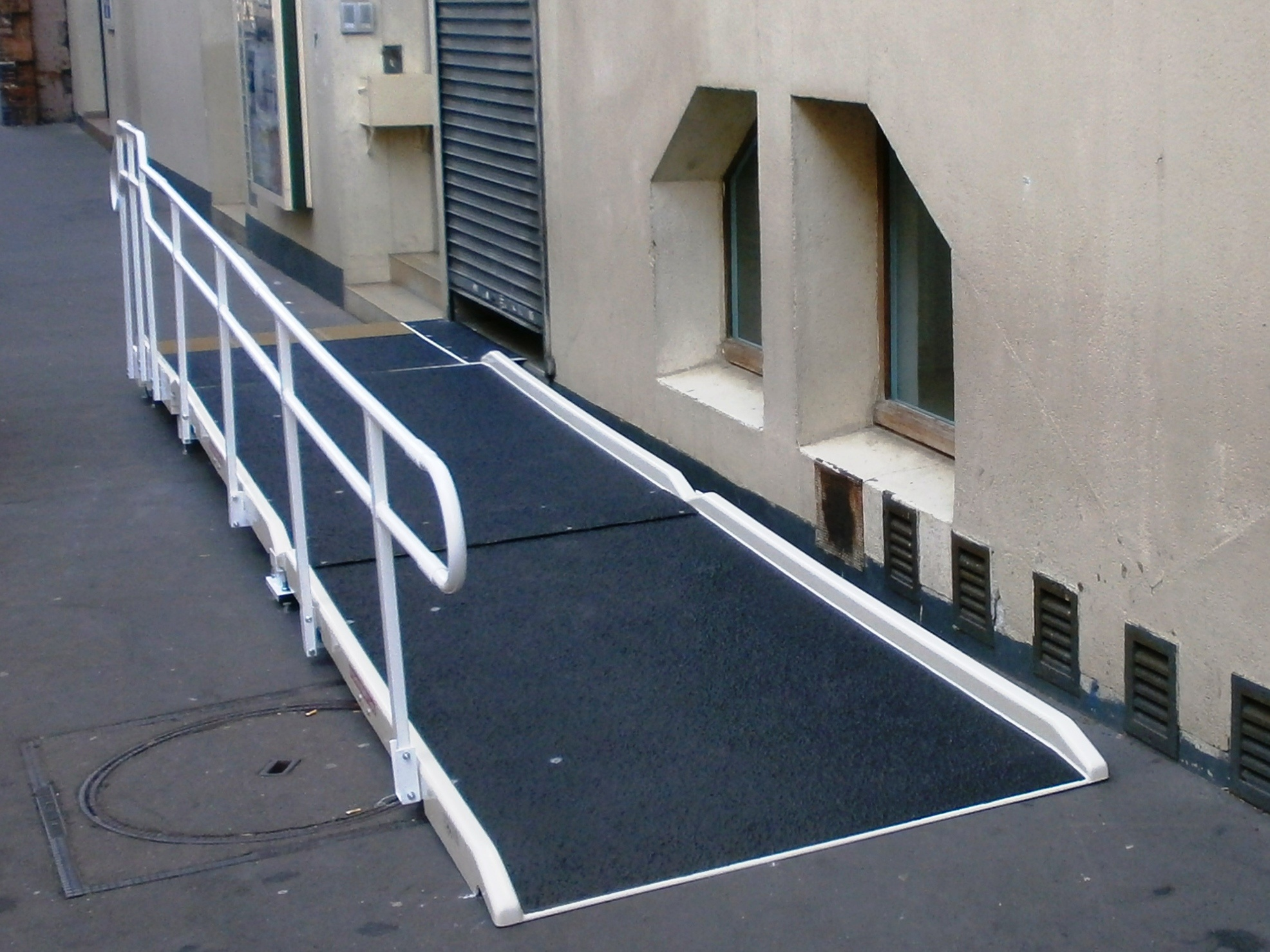 Access to a shop in town with a Jetmarine fibreglass standard access ramp and one handrail