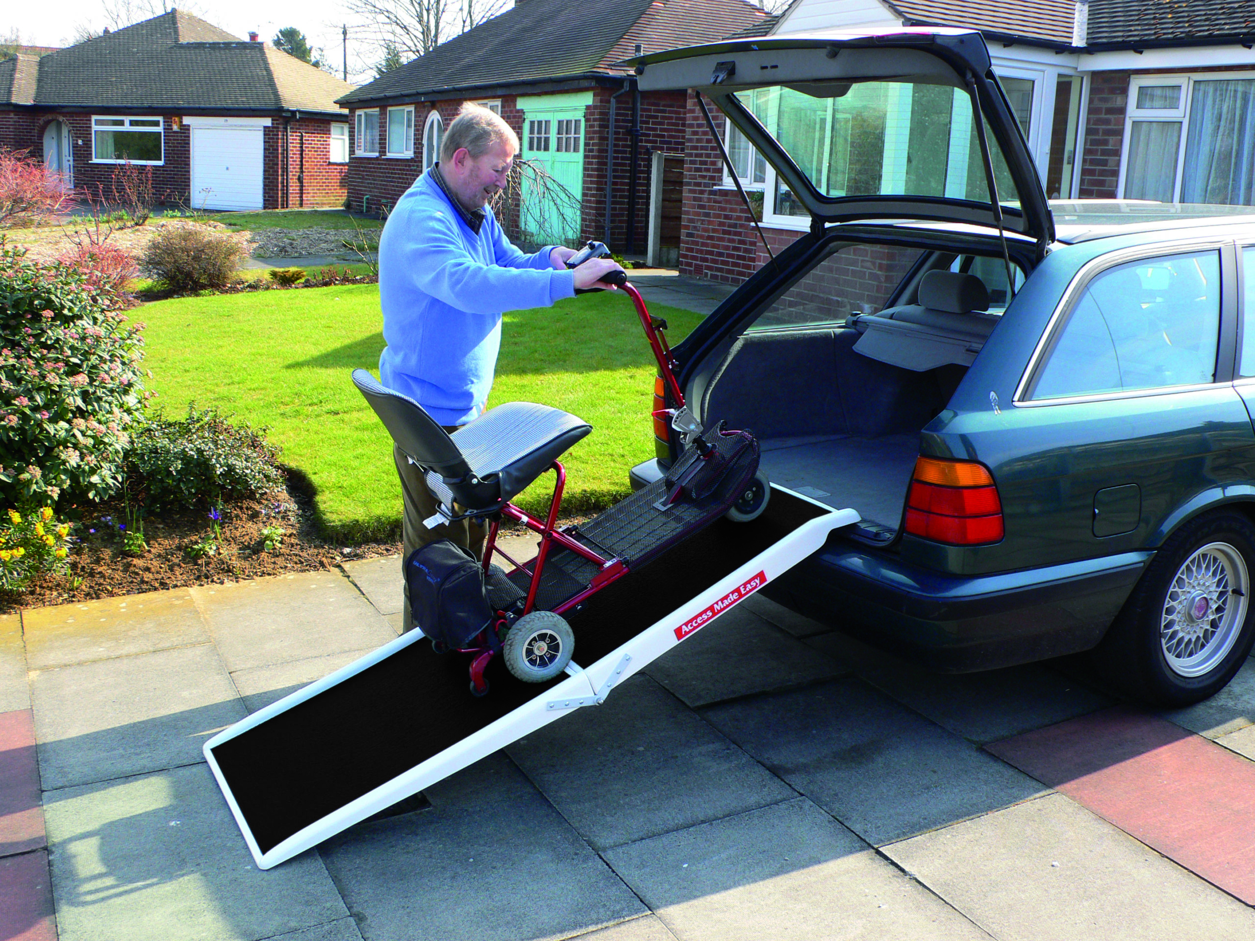 Loading an Electric Conveyance Vehicles into a car with a fibreglass scooter ramp